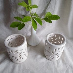 Two matching candleholders. White color